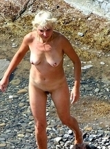 Blonde MILF caught totally naked on the beach